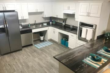Our spacious kitchen comes fully applianced in stainless steel, and offers ample cabinet space.
