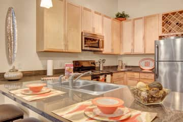 Residence At The COR Kitchen with Stainless Steel Appliances
