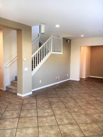 Bigem 2 living room and stairs looking toward entry.JPG