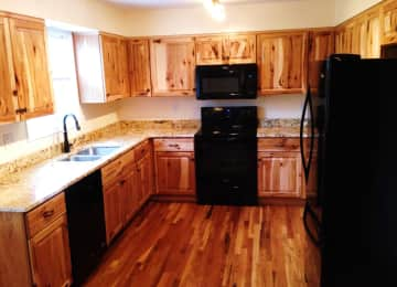 Rustic hickory cabinets/granite countertops