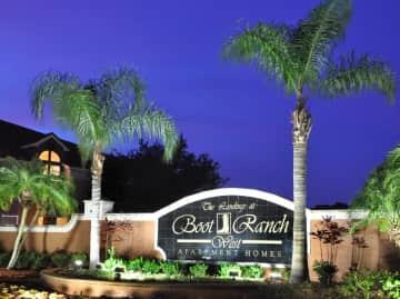 Landings at Boot Ranch Apartments Sign at Night