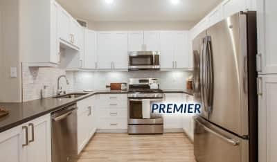 Modern kitchen features stainless steel appliances, quartz countertops, french door refrigerator and designer cabinets