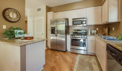 Select kitchens feature stainless steel appliances and include granite countertops