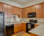 A large kitchen with lots of cabinet sorage, deep double sinks, and plenty of counter space, Riverside 9 Apartments