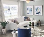 Spacious living rooms with wood-style flooring and a ceiling fan., Dunlap Falls