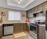 Sleek stainless steel appliances and warm wood-tone cabinets give your kitchen a modern feel, Grammercy Apartments