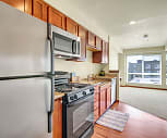 Galley style kitchen with refrigerator, dishwasher, stove, oven, microwave and plenty of cabinet storage, Aventine