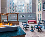 Resident courtyard with BBQ grill and fireplace, TwentyOne01 on Market Apartments