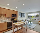 A beautiful kitchen with tile backsplash and sleek appliances., Woodin Creek Village