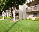 view of building exterior with a large lawn, Town & Country Apartments - Brea