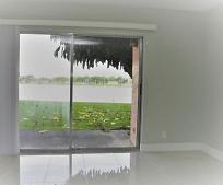 8700 Sherman Cir N, Country Club, FL