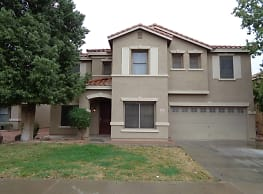 This 4 bedroom, 2.5 bath home has 3,360 square fee - Surprise