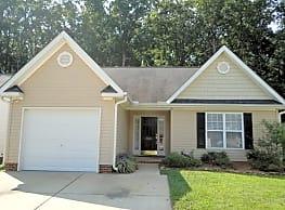This 3 bedroom, 2 bath home has 1228 square feet o - Greensboro