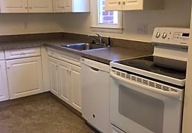 kitchen with fume extractor, electric range oven, dishwasher, pendant lighting, dark countertops, white cabinetry, and dark tile floors, Chestnut Hill North