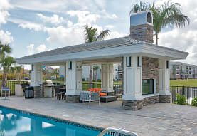 view of shed / structure with an outdoor kitchen and a swimming pool, The Reserve at Vero Beach
