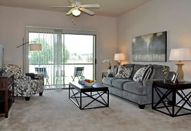 carpeted living room with a ceiling fan, plenty of natural light, and TV, Stockwell Landing