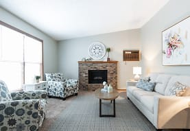 carpeted living room with natural light, Creekstone Falls