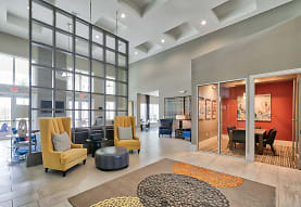 community lobby featuring a high ceiling and parquet floors, The Reserve at Vero Beach
