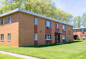 view of property with a large lawn, Eastlake Terrace & Maple Park Apartments