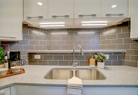 kitchen featuring stone countertops and white cabinets, Latitude 43