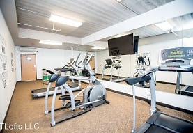 gym featuring carpet, beamed ceiling, and TV, T-Lofts Apartments