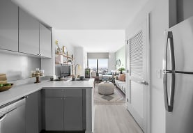 kitchen featuring natural light, stainless steel refrigerator, dishwasher, TV, light floors, white cabinets, and light countertops, Journal Squared