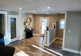 kitchen featuring a healthy amount of sunlight, stone countertops, and dark parquet floors, Bradley Square