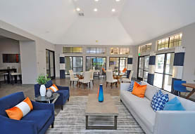 hardwood floored living room featuring vaulted ceiling, The Lory of Perimeter