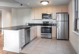 kitchen featuring stainless steel appliances, range oven, white cabinets, dark stone countertops, and light tile flooring, Liberty Tower