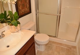 full bathroom featuring tile floors, shower with glass door, mirror, toilet, and vanity, Meadows at Bumble Bee Hollow