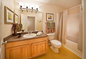 full bathroom featuring tile floors, vanity with extensive cabinet space, mirror, toilet, shower curtain, and shower / bath combination, Old Town on the Monon