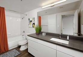 full bathroom featuring vanity, toilet, shower / washtub combination, mirror, and shower curtain, AVA Ballston Square