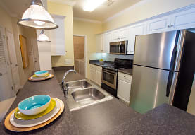 kitchen with stainless steel appliances, electric range oven, white cabinetry, pendant lighting, and dark stone countertops, Sugar Mill