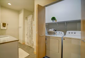 clothes washing area featuring tile flooring and separate washer and dryer, Latitude 43