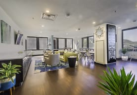 lobby featuring hardwood floors, natural light, and TV, River Vue