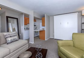 carpeted living room with range oven, dishwasher, and microwave, Autumn Ridge Studio