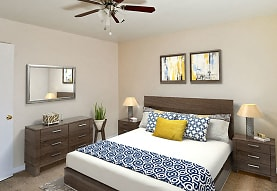 bedroom featuring a ceiling fan and carpet, Acadian and South College Gardens