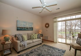 carpeted living room featuring a healthy amount of sunlight and a ceiling fan, Prospect Commons
