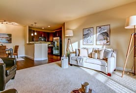 carpeted living room featuring refrigerator and microwave, Copper Creek Apartments