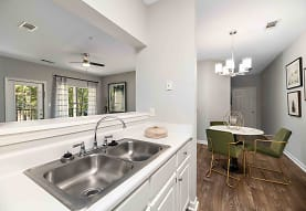 kitchen with a ceiling fan, dark parquet floors, pendant lighting, white cabinets, and light countertops, Walden Pond