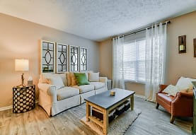 hardwood floored living room with natural light, Hilliard Station Apartments
