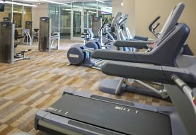 workout area featuring hardwood flooring and TV, District at Medical Center