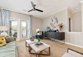 carpeted living room featuring a ceiling fan and natural light, Lakeside Village
