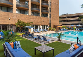 view of pool featuring an expansive lawn, The Point at Pentagon City