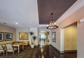 building lobby with parquet floors and a notable chandelier, District at Medical Center