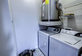 laundry area with separate washer and dryer and water heater, Audubon Lake Apartment Homes