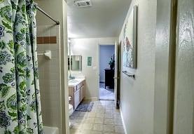 bathroom featuring tile flooring, oversized vanity, shower curtain, toilet, and mirror, Audubon Lake Apartment Homes