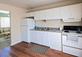 kitchen featuring natural light, refrigerator, electric range oven, range hood, white cabinets, and light parquet floors, Acadian and South College Gardens