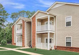 back of property featuring a lawn, Park At Lemoyne Apartments