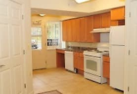 kitchen featuring range oven, refrigerator, extractor fan, dishwasher, light tile flooring, and brown cabinets, The Larkspur